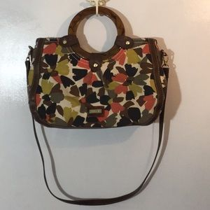 Relic handbag with round handles and strap